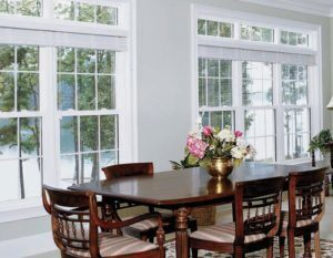 Dining room view of the outdoors through windows